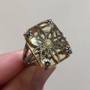 Yellow colored ring with flower design. Size 7.5
